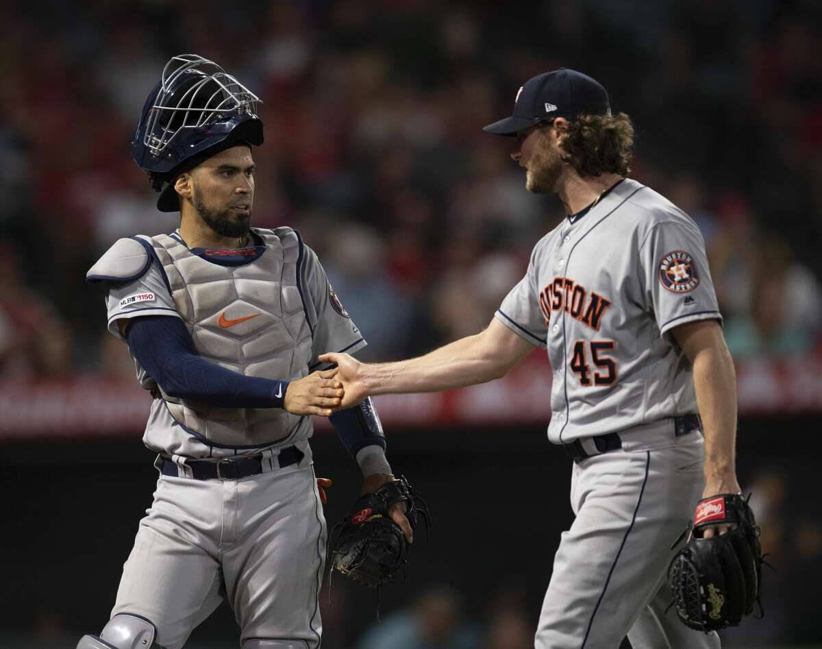 Houston Astros catcher Robinson Chirinos, left, and starting pitcher Gerrit Cole in a baseball game against the Los Angeles Angels in Anaheim, Calif., Wednesday, July 17, 2019. (AP Photo/Kyusung Gong)