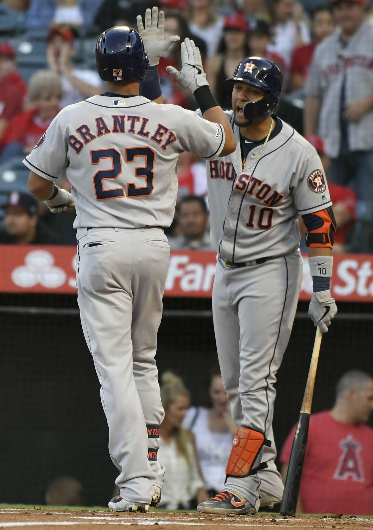 Michael Brantley #23 of the Houston Astros is congratulated by Yuli Gurriel #10 for his two run home run in the first inning against the Los Angeles Angels of Anaheim at Angel Stadium of Anaheim on July 17, 2019 in Anaheim, California. (John McCoy/Getty Images/TNS)