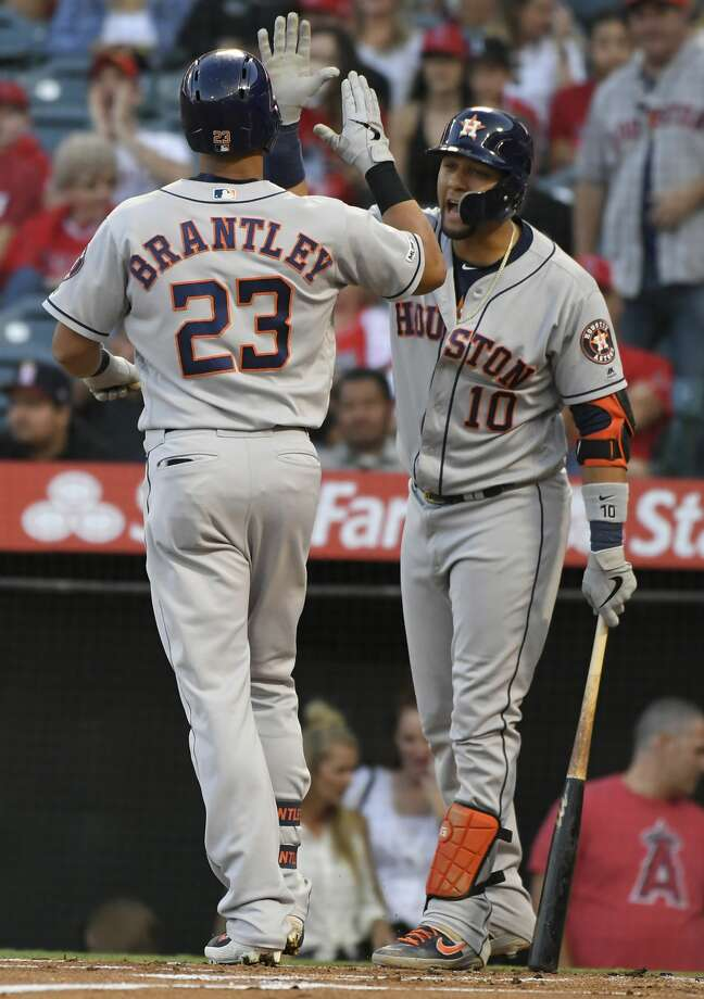 Michael Brantley #23 of the Houston Astros is congratulated by Yuli Gurriel #10 for his two run home run in the first inning against the Los Angeles Angels of Anaheim at Angel Stadium of Anaheim on July 17, 2019 in Anaheim, California. (John McCoy/Getty Images/TNS) Photo: John McCoy/TNS