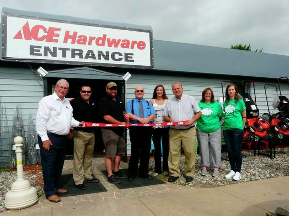 Jerry Putt, Byron Clouse, Brandon Clouse, Bob Duponce, Samantha Kunz, Lee Kilbourn, Robin Naugle and Tonya Short participate in a ribbon-cutting ceremony Friday to celebrate the official grand opening of a new Ace Hardware Store, in Auburn.