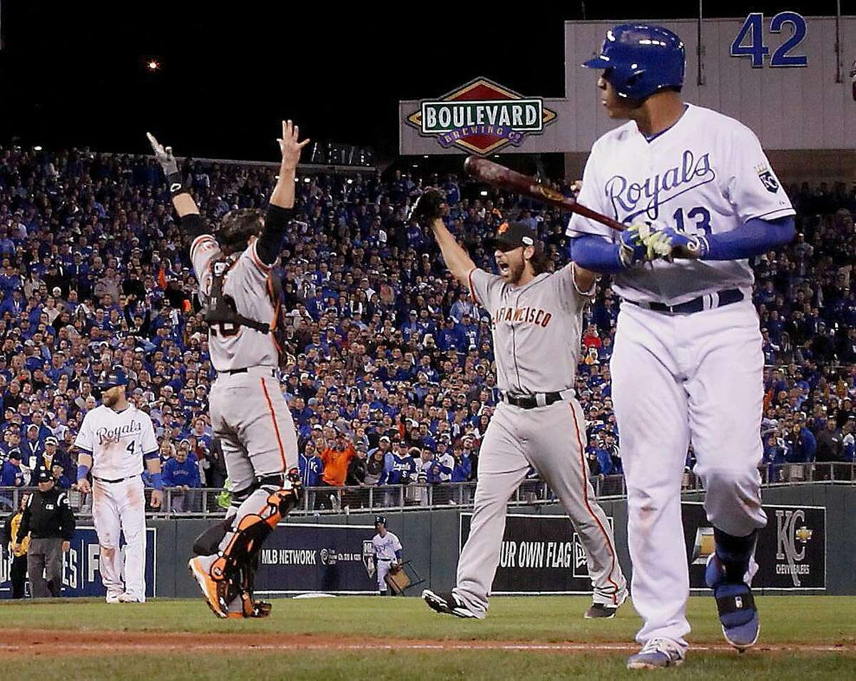 Giants Buster Posey and Madison Bumgarner celebrate the last out in Game 7 of the World Series at Kauffman Stadium on Wednesday, Oct. 29, 2014 in Kansas City, Mo.