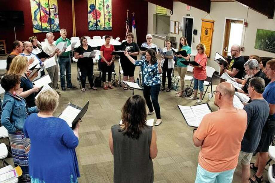 Abby Musgrove (center), founder and director of the Spero Chamber Chorale, leads a rehearsal of the choir, which will open its second season on Saturday. Photo: Photo Provided