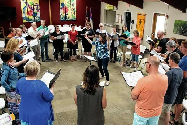 Abby Musgrove (center), founder and director of the Spero Chamber Chorale, leads a rehearsal of the choir, which will open its second season on Saturday.