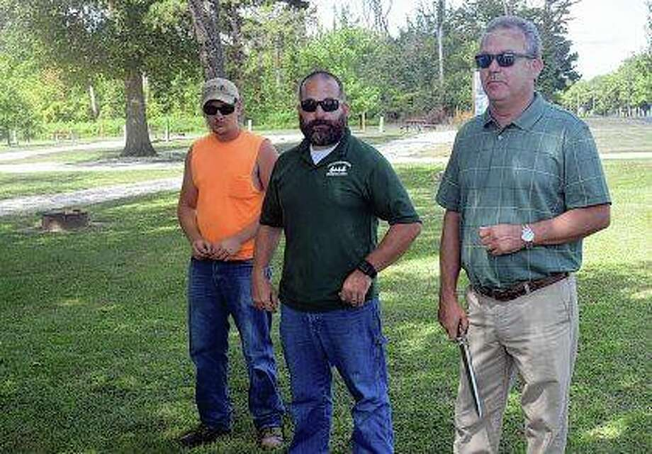 City Parks and Lakes Department employee Bryce Ballenger (from left), Lake Jacksonville site manager Brett Gilbreth and Kelly Hall, director of community development and recreational facilities, get ready to take part in a ribbon-cutting ceremony marking the completion of the first phase of the North Side Trail at Lake Jacksonville. Photo: Marco Cartolano | Journal-Courier