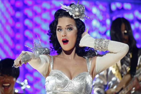 "Train and Katy Perry were two performers who played Tuesday night in front of television cameras in preparation for the Grammy nominations show on Wednesday evening. Katy Perry performed her song ""California Gurls."""