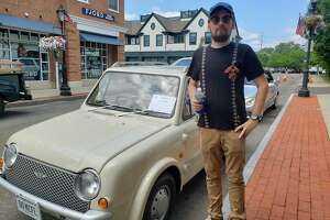 Norwalk resident Richard Errington stands in front of his 1989 Nissan Pao, a Japanese car he imported. The Collectible Car Show took place on Saturday, July 13, at the Darien Sidewalk Sales and Family Fun Days on Day Street and behind Laurel Road Bank on Post Road.