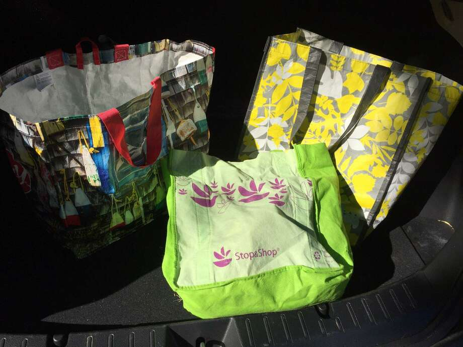 Some reusable bags for shopping in place of plastic bags, which have recently been banned in Darien. Photo: Rebecca Martorella / / Connecticut Post