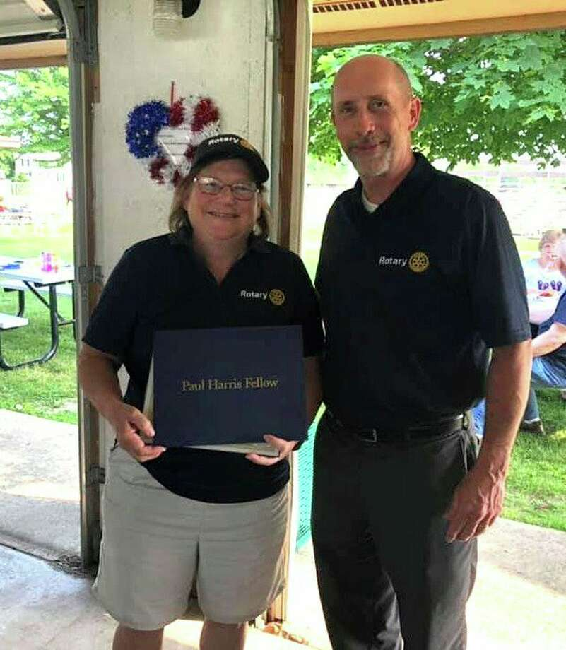 Past-President George Rierson presented outgoing President Cindy Parsons with the prestigious Paul Harris Fellowship Award as a thank you for her dedication and tenure at the helm. (Submitted Photo)