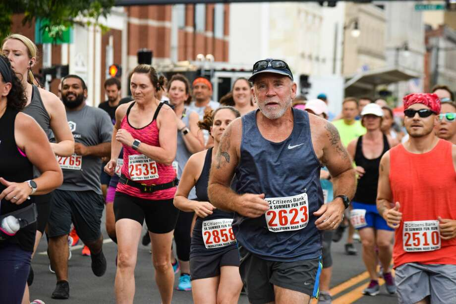 The Citizens Bank 5k Summer Fun Run and Bed Race was held Wednesday on Main Street and featured a kids race, live music and street performers.  Photo: Michelle France