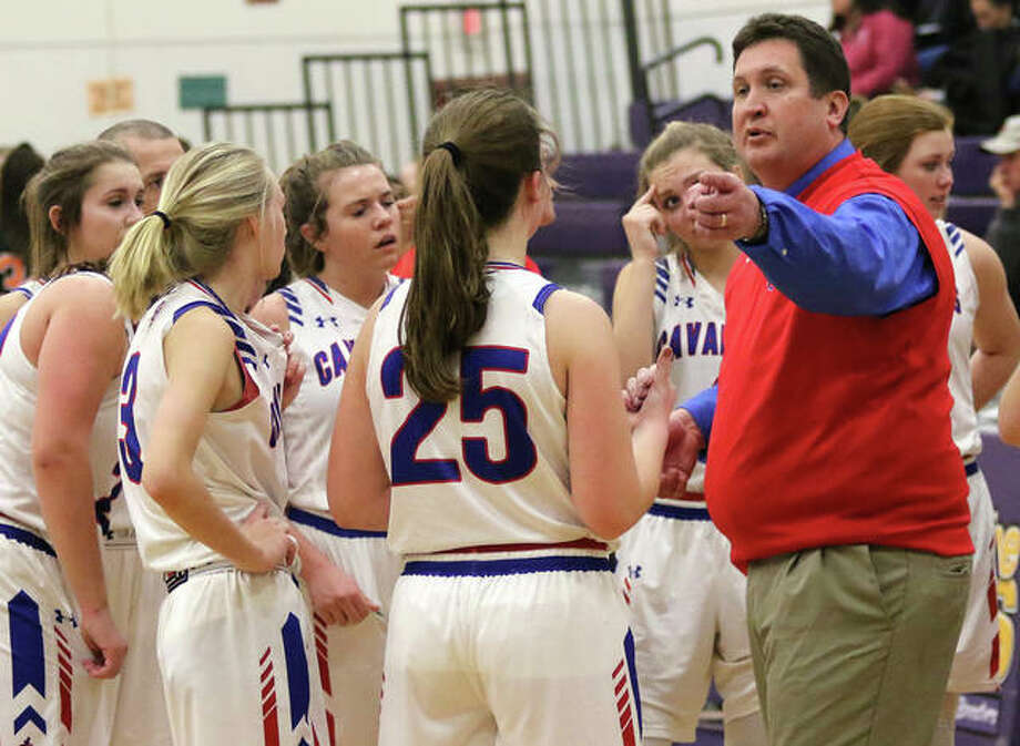 Carlinville coach Darrin DeNeve (right) offers input to his daugher Sarah DeNeve (25) during a timeout at the Macoupin County Tournament in Mount Olive. Darrin DeNeve guided the Cavalier to a 20-5 record to earn 2018-19 Telegraph Small-Schools Girls Basketball Coach of the Year. Photo: Greg Shashack / The Telegraph
