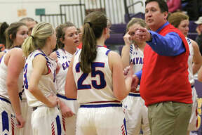 Carlinville coach Darrin DeNeve (right) offers input to his daugher Sarah DeNeve (25) during a timeout at the Macoupin County Tournament in Mount Olive. Darrin DeNeve guided the Cavalier to a 20-5 record to earn 2018-19 Telegraph Small-Schools Girls Basketball Coach of the Year.