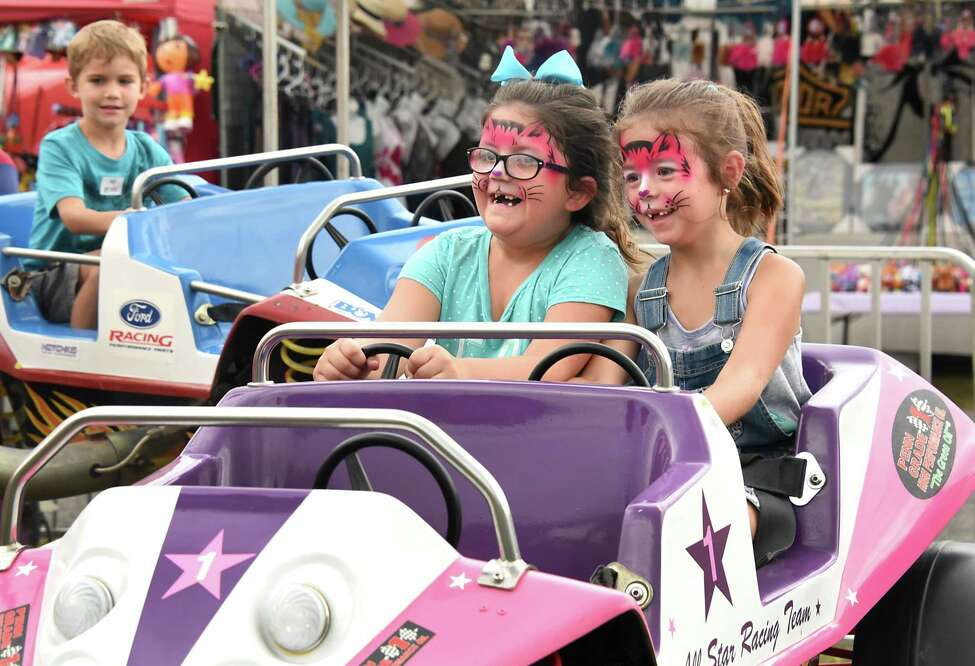 Six-year-old cousins Harliegh Hill, left and Grace Brisk, 6, both of Galway enjoy a bouncy car ride at the Saratoga County Fair on Wednesday, July 25, 2018 in Ballston Spa, N.Y. (Lori Van Buren/Times Union)