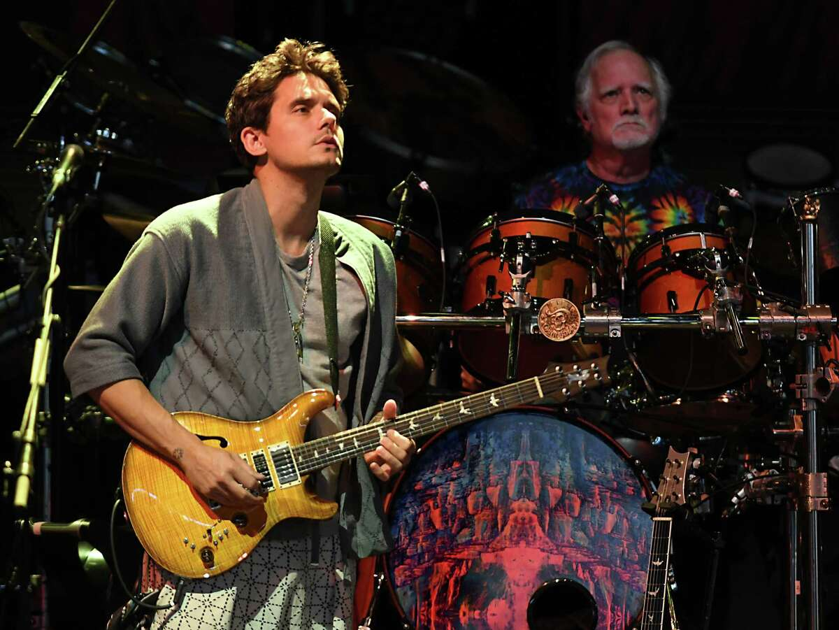 Dead & Company including John Mayer, left, and Bill Kreutzmann perform the song