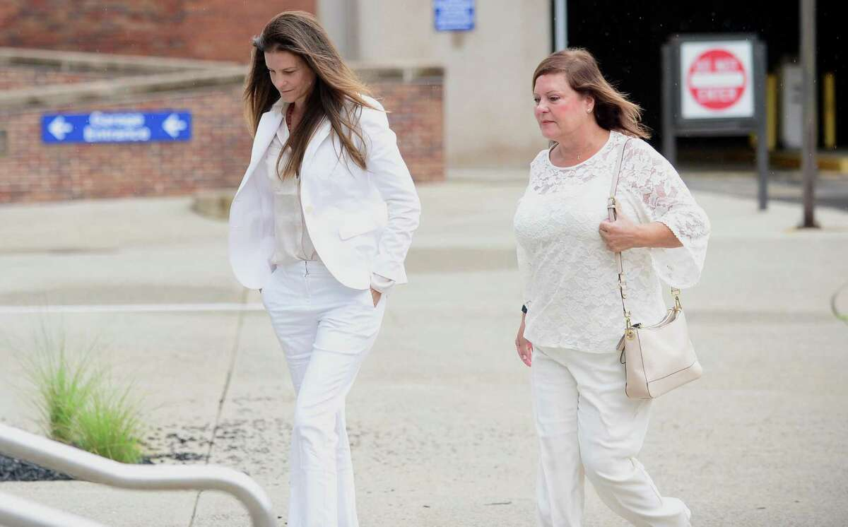 Michelle Troconis, left, arrives at the Stamford courthouse on Thursday with her mother, Marisela Arreaza.