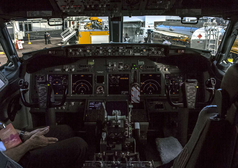A pilot sits inside the cockpit of a Boeing 737-800 during the International Brazil Air Show at Rio Galeao International Airport in Rio de Janeiro on April 1, 2017. Photo: Bloomberg Photo By Dado Galdieri. / 2017 Bloomberg Finance LP