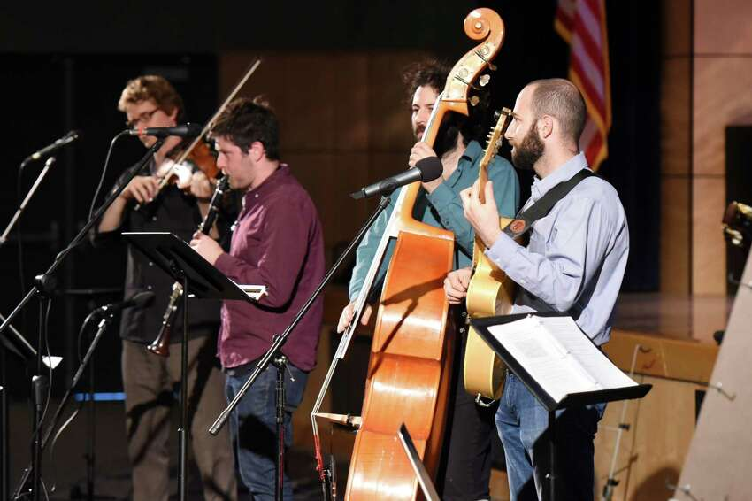 Band members of Hot Club of Saratoga perform various songs during a musical demonstration on Tuesday, May 21, 2019 at Maple Ave Middle School in Saratoga Springs, NY. (Phoebe Sheehan/Times Union)