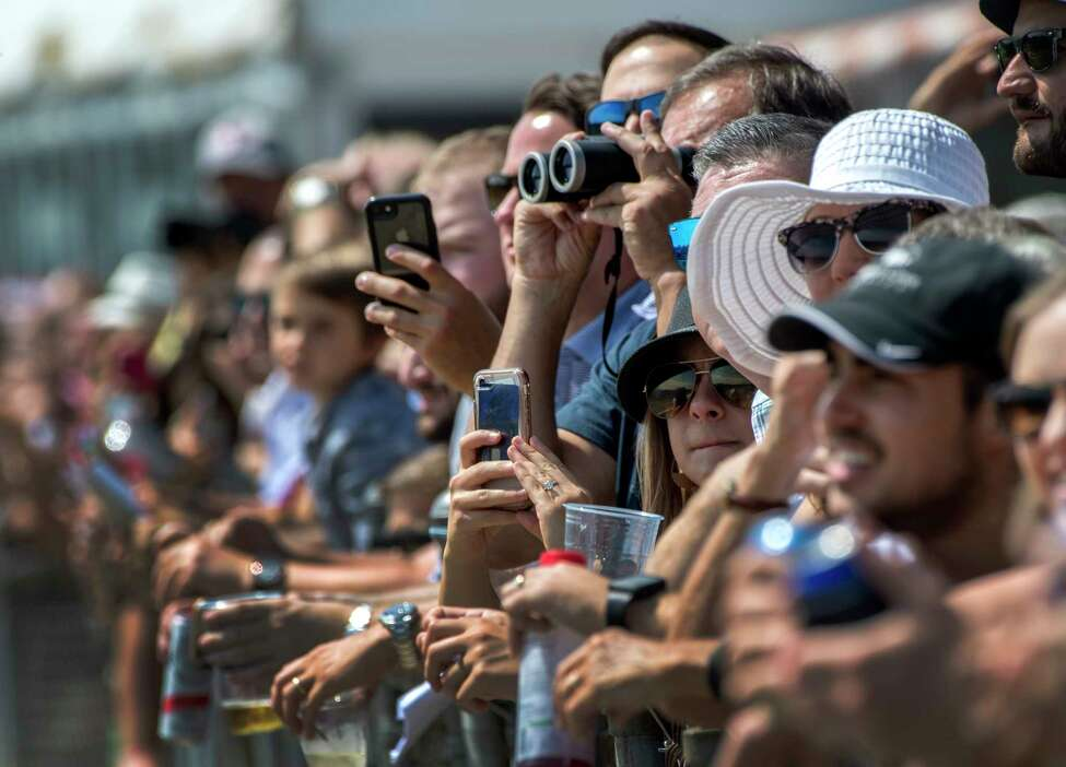 Racing patrons use all types of apparatus to capture racing on Travers Day at the Saratoga Race Course Saturday Aug. 25th in Saratoga Springs, N.Y. (Skip Dickstein/Times Union)