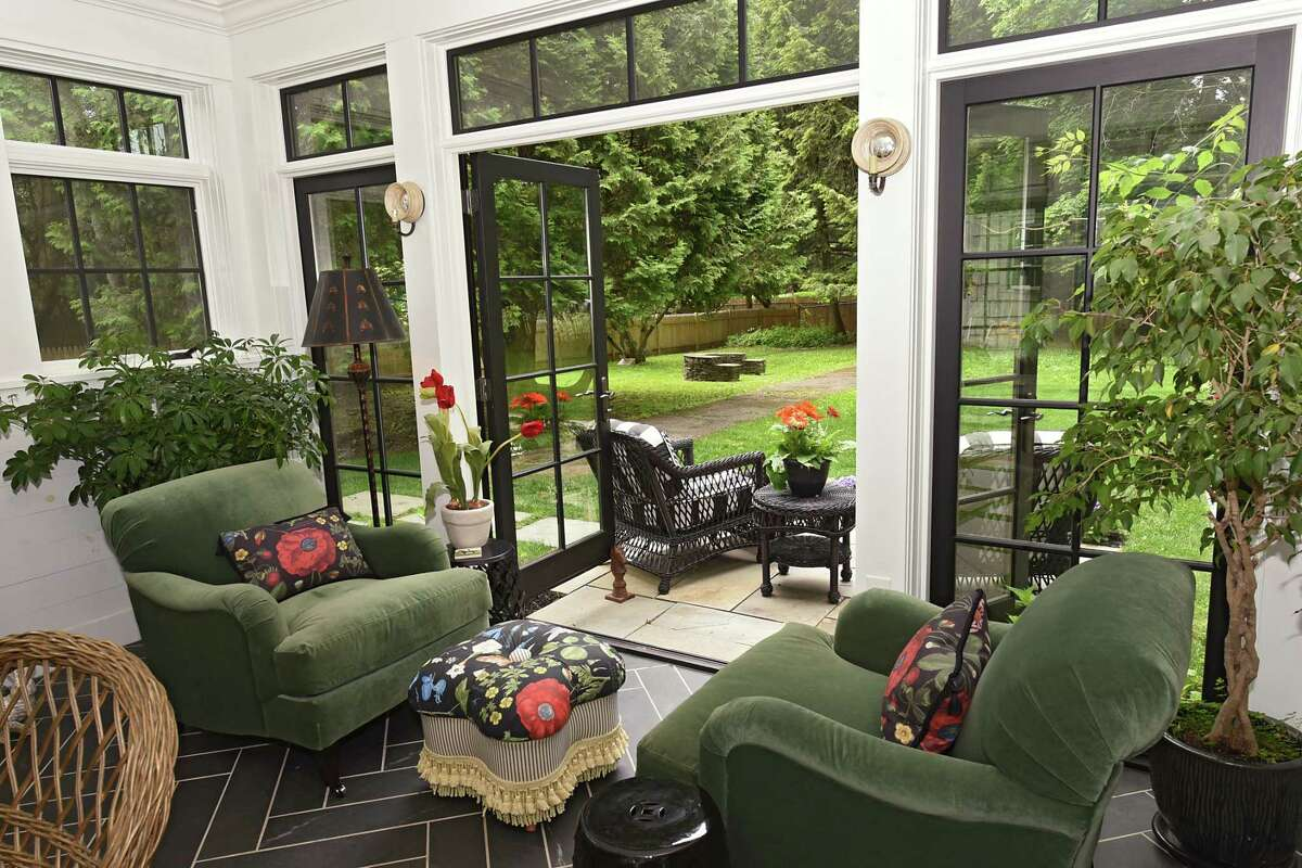 Four season sunroom with doors leading to outdoor patio in the home of Charlene Wood and James Paratore on Friday, June 14, 2019 in Saratoga Springs, N.Y. (Lori Van Buren/Times Union)