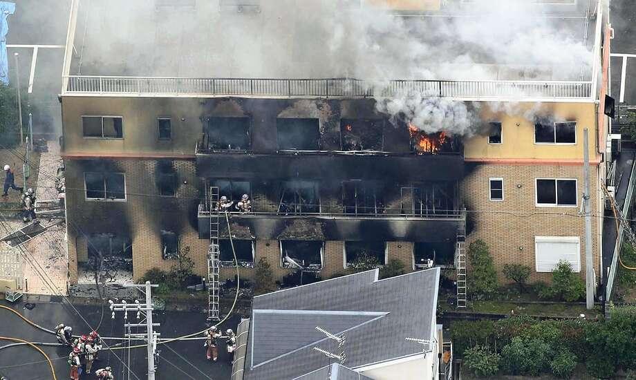 Smoke and flames are seen at a studio building belonging to Kyoto Animation Co. in Fushimi Ward, Kyoto, Japan, on Thursday. Photo: Japan News-Yomiuri / Japan News-Yomiuri