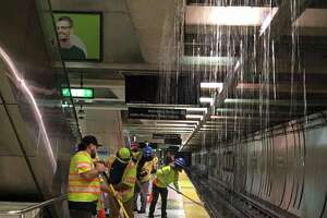 BART shared this photo of employees dealing with flooding at Embarcadero station. Trains are not stopping at Embarcadero due to flooding from the Muni level pouring into the station. Trains are running through the station but will make all other stops.