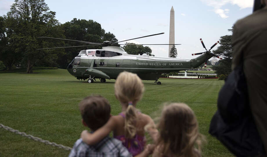Visitors watch as Marine One, carrying President Trump, prepares to takes off on the South Lawn of the White House in Washington on July 17, 2019. MUST CRECIT: Bloomberg photo by Alex Edelman. Photo: Alex Edelman, Bloomberg / 2019 Bloomberg Finance LP
