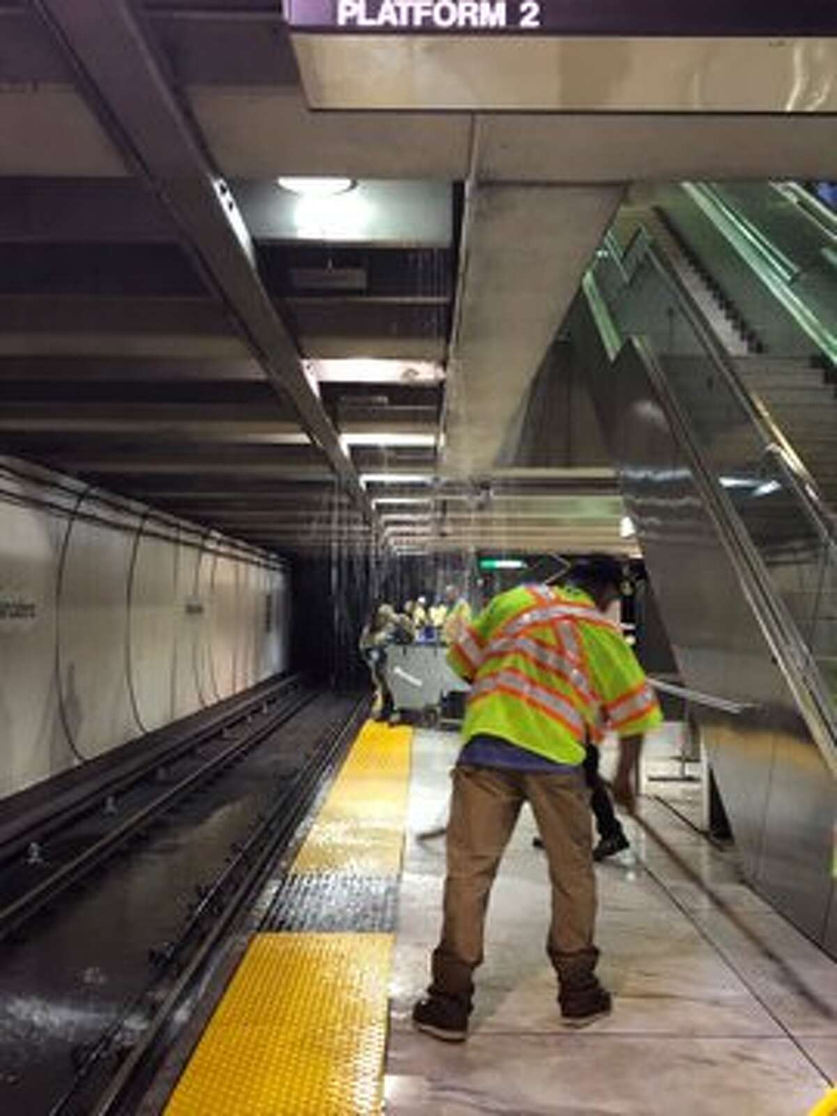 BART employees are dealing with flooding issues at the Embarcadero station on Thursday morning, July 18, 2019. The water was leaking from the SF Muni platform above.