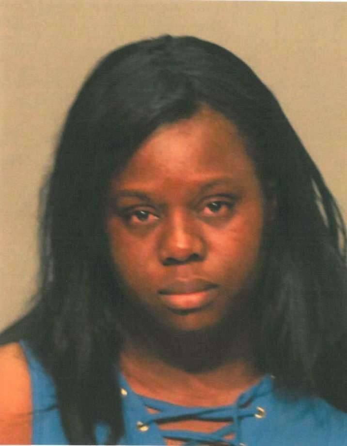 Julienne Julmeus, 25, of Stamford, pleaded guilty to the first-degree larceny theft of $106,000 from her convenience store on East Putnam Avenue in Greenwich. A Stamford judge will keep the ex-store manager out of jail as long as she begins paying the money back. Photo: Greenwich Police Department / Contributed
