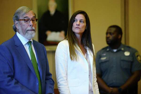 Michelle Troconis and her legal team including Andrew Bowman, left, arrange their next court date in her appearance for tampering with evidence and hindering the investigation into the disappearance of Jennifer Dulos at Stamford Superior Court Thursday, July 18, 2019 in Stamford, Conn.