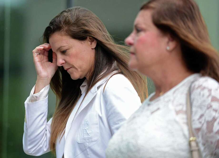 Michelle Troconis, with her mother, arrives for her court July 18 to face charges in the the disappearance of Jennifer Dulos. Photo: Erik Trautmann / Hearst Connecticut Media / Norwalk Hour