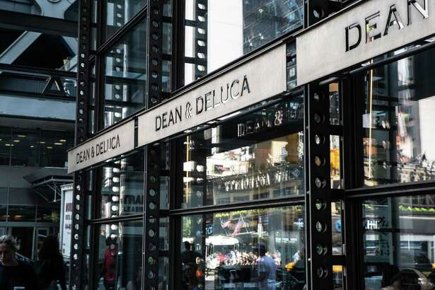 Signs for Dean & DeLuca are seen at Time Square store in New York City on July. 17, 2018.