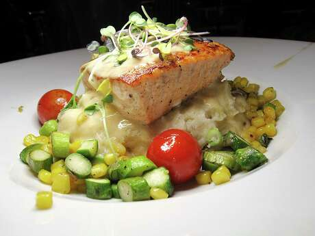 Salmon comes with lobster mashed potatoes and asparagus-corn succotash at Cappy's.