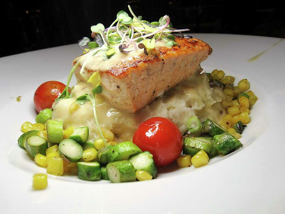 Salmon comes with lobster mashed potatoes and asparagus-corn succotash at Cappy's. Photo: Mike Sutter /Staff