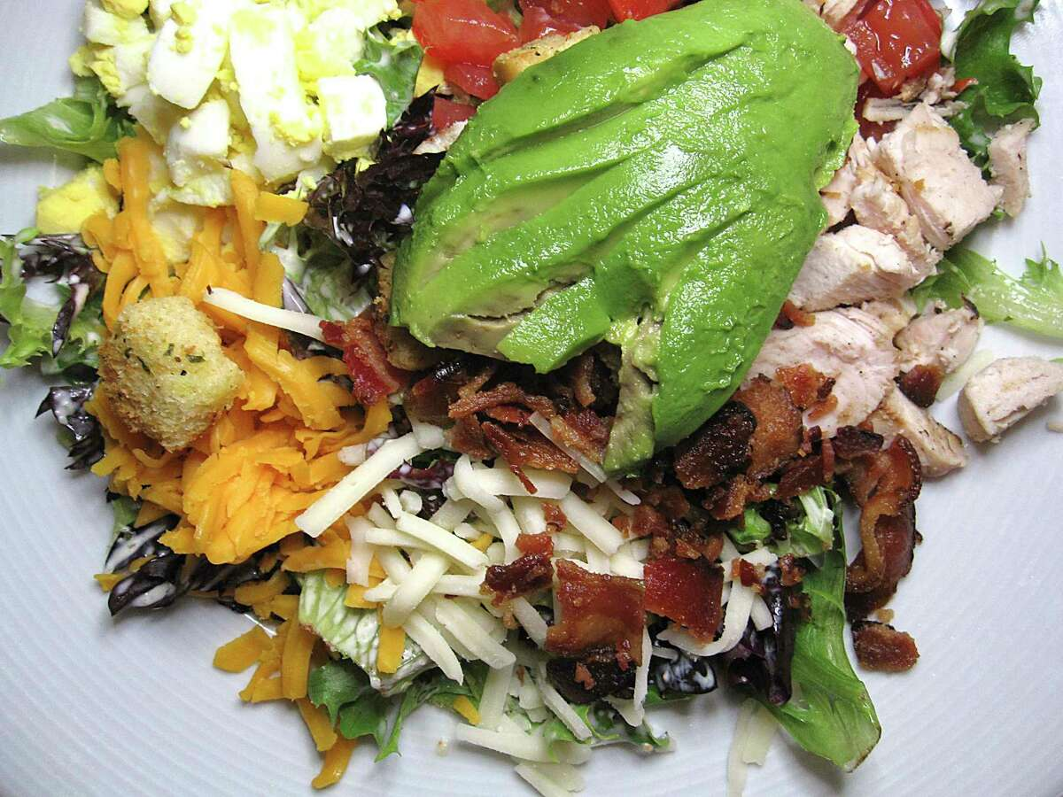 A Cobb salad, available at lunch and brunch, comes with chicken, cheese, smoked bacon, boiled egg, tomatoes and avocado at Cappy's.