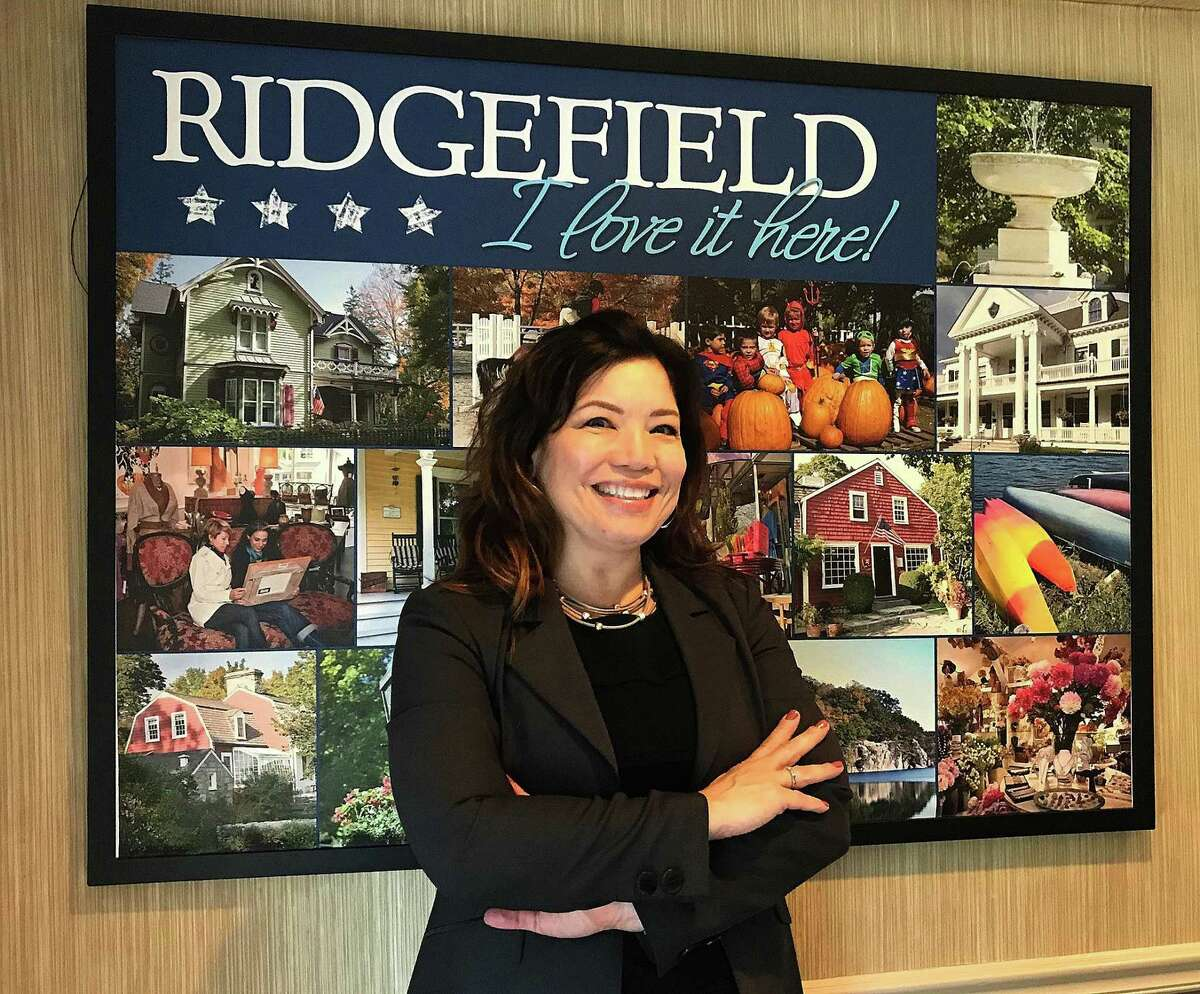 Kim Bova, new executive director of the Ridgefield Chamber of Commerce, stands in the organization's office in Ridgefield, Conn., on Thursday, Oct. 11, 2018.