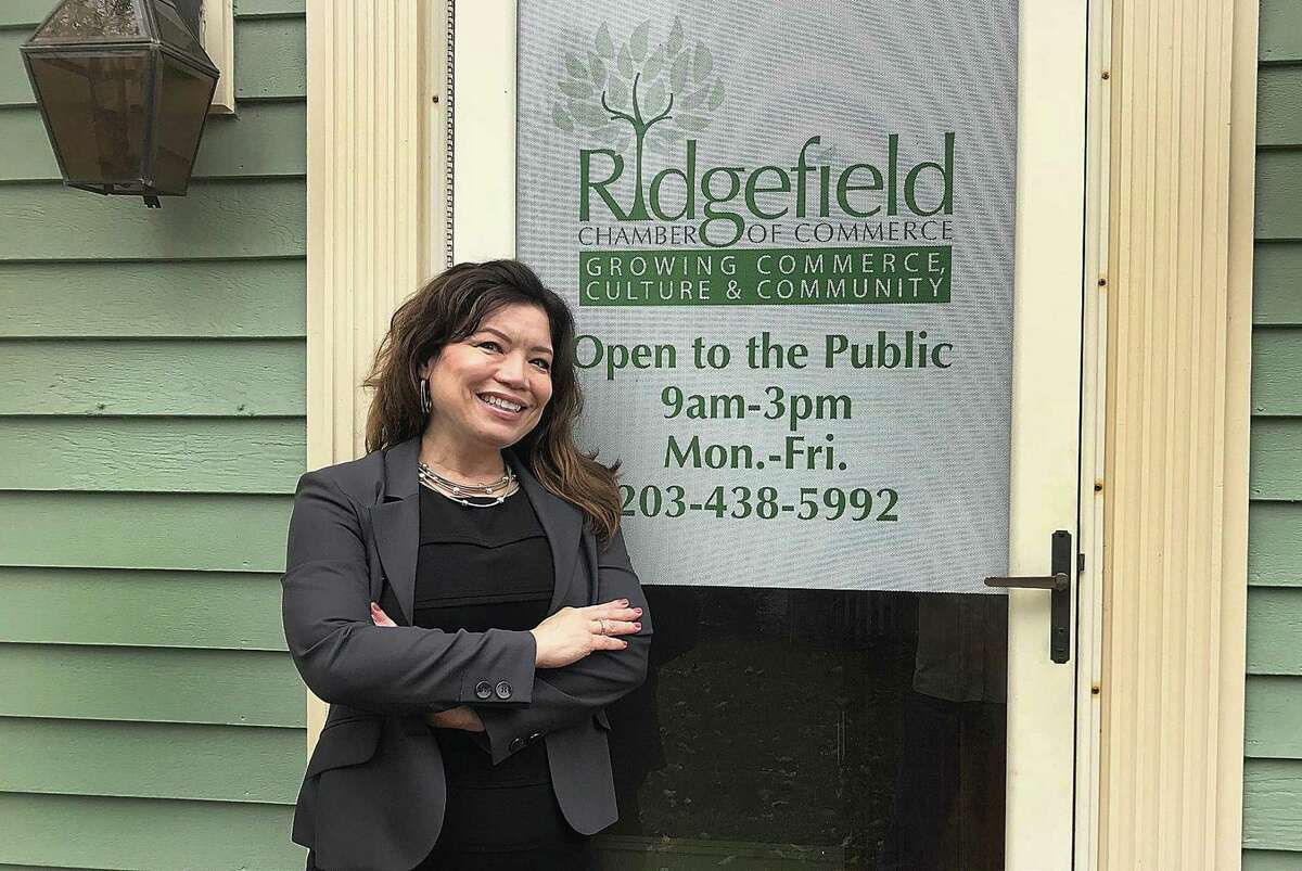 Kim Bova, new executive director of the Ridgefield Chamber of Commerce, stands outside of the organization's office in Ridgefield, Conn., on Thursday, Oct. 11, 2018.