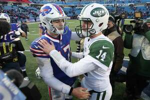 BUFFALO, NY - DECEMBER 09: Josh Allen #17 of the Buffalo Bills shares an embrace with Sam Darnold #14 of the New York Jets after their NFL game at New Era Field on December 9, 2018 in Buffalo, New York.
