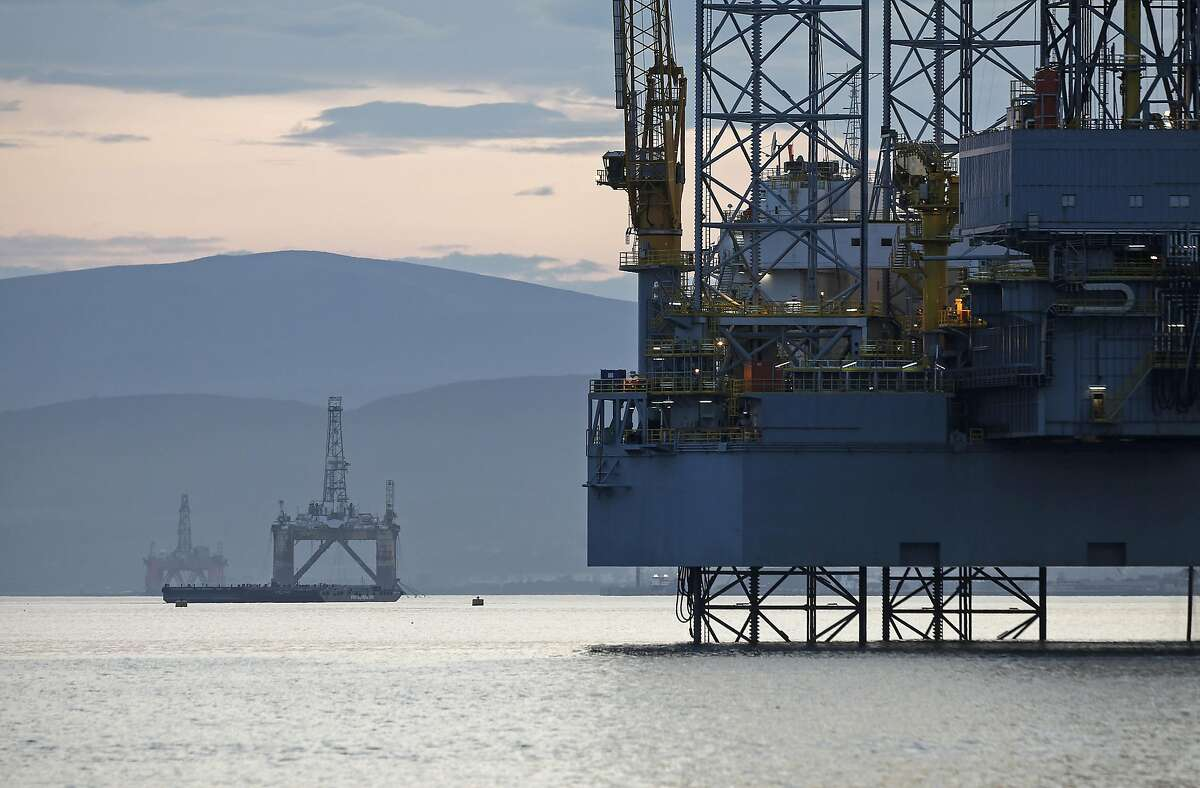 Offshore drilling rigs Ocean Vanguard, operated by Diamond Offshore Drilling Inc., left, J. W. McLean, operated by Transocean Ltd., center, and Prospector 1, operated by Prospector Offshore Drilling SA, right, stand anchored in the Cromarty Firth in Cromarty, U.K., on Tuesday, Aug. 5, 2014.