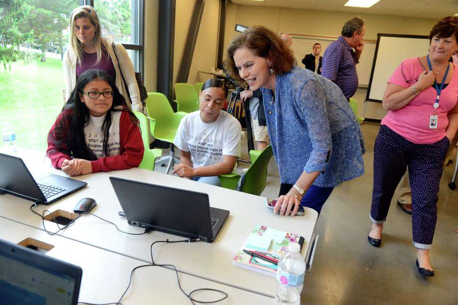 Tiana Adler, 12, left, and Miranda Diaz, 13, center, show Assemblywoman Patricia Fahy, right, their website design for AT&T and Capital Region STEM Hub All Girls Middle School Summer Coding Camp on Thursday, July 18, 2019, in Albany, N.Y. Adler and Diaz created a website to raise awareness for the gender wage gap. (Catherine Rafferty/Times Union) Photo: Catherine Rafferty, Albany Times Union / 40047497A