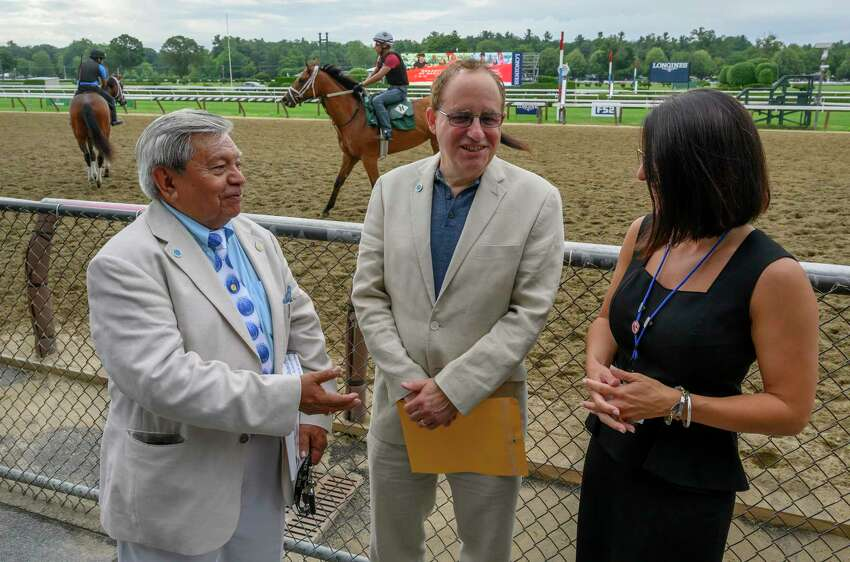 Rudy Rios, Founder of the Backstretch Workers Service Team(BEST), left speaks with Paul Ruchames, executive director, center and Nancy Underwood, Saratoga program director at the 30th anniversary of BEST breakfast Thursday July 18 2019 in Saratoga Springs, N.Y. Special to the Times Union by Skip Dickstein