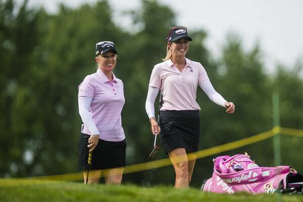 Morgan Pressel of Florida, left, and playing partner Paula Creamer of California, right, walk toward the 18th hole as they play in the second round of the Dow Great Lakes Bay Invitational on Thursday, July 18, 2019 at Midland Country Club. (Katy Kildee/kkildee@mdn.net)