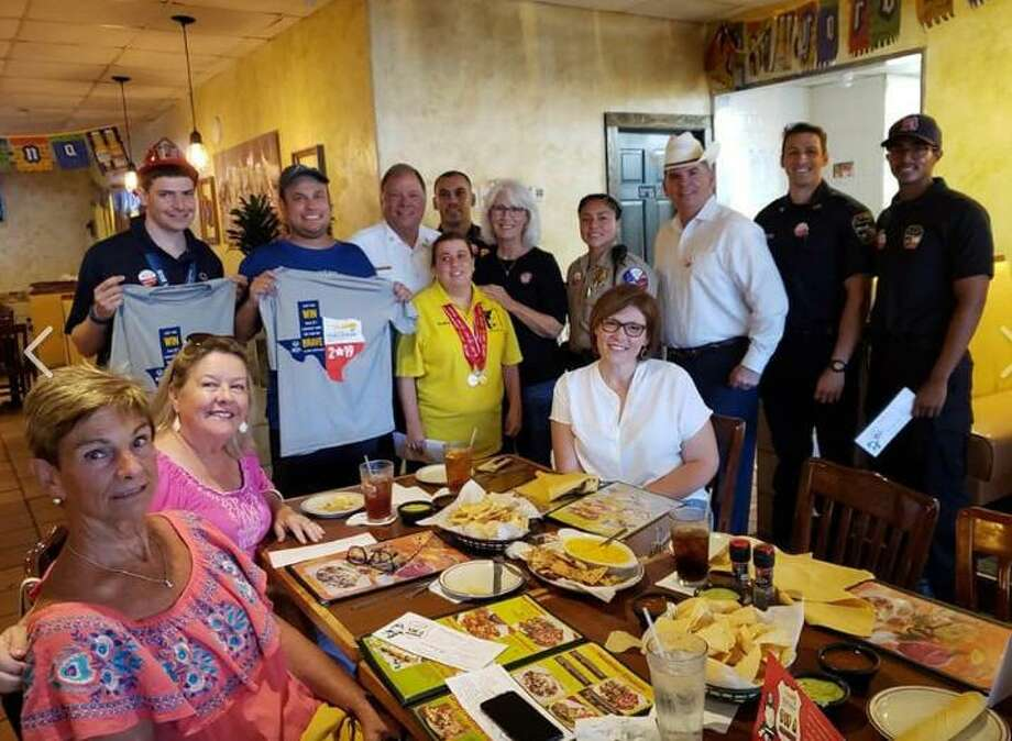 Members of the Katy Fire Department teamed up for the first time with members of the Katy Police Department for the Tip A Firefighter/Tip A Cop program to raise funds on July 12 for Special Olympics Texas at The Original Los Cucos in Katy. Photo: Https://www.facebook.com/KatyFireDept/ / Https://www.facebook.com/KatyFireDept/