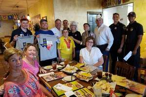 Members of the Katy Fire Department teamed up for the first time with members of the Katy Police Department for the Tip A Firefighter/Tip A Cop program to raise funds on July 12 for Special Olympics Texas at The Original Los Cucos in Katy.
