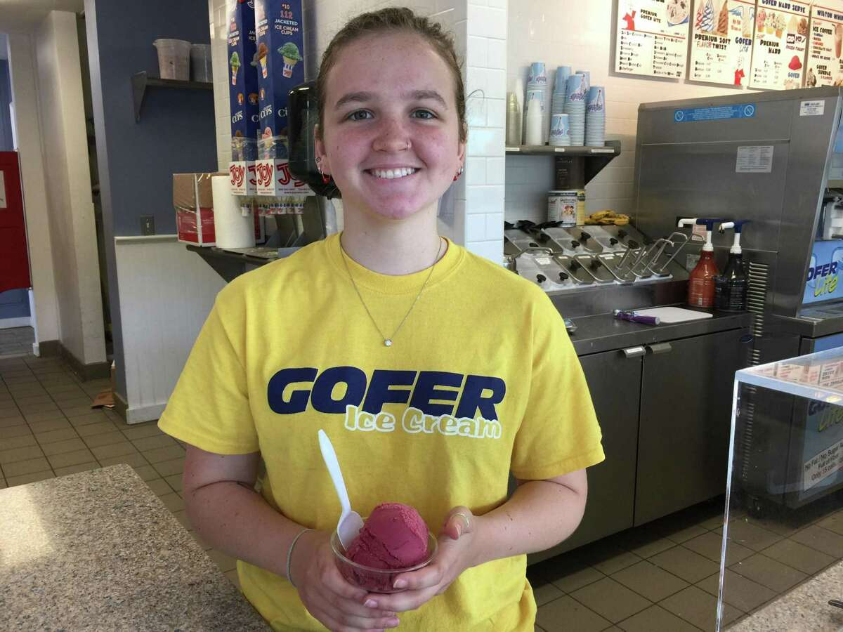 Alison Danvers serves up a cup of raspberry sorbet at Gofer Ice Cream Shop.