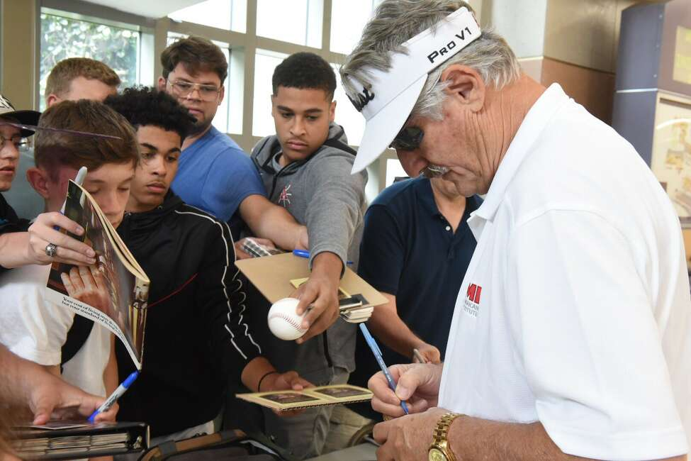 Hall of Famer Rollie Fingers signs autographs Thursday at Albany International Airport after flying in for this weekend's induction ceremony.
