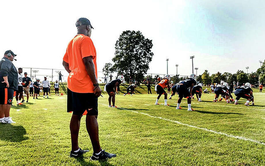 University of Illinois football coach Lovie Smith oversees a preseason practice session last August in Champaign. The Illini will open this summer's preseason camp Aug. 2. Photo: Telegraph File Photo