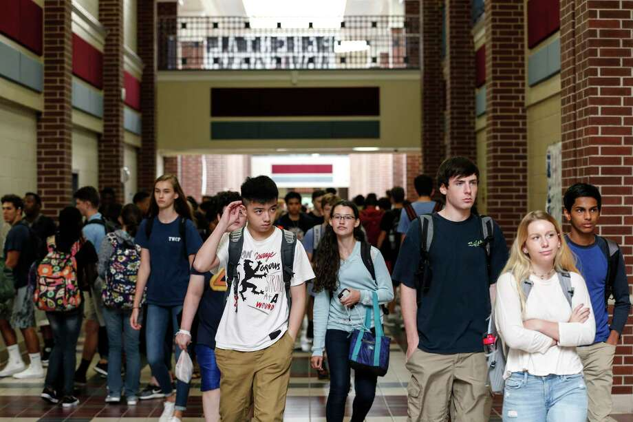Conroe Independent School District administrators seem satisfied after receiving students' 2019 preliminary State of Texas Assessments of Academic Readiness and End-of-Course test scores that show increases in many areas as well as scores that consistently out-pace the state averages. In this file photo, students walk the hallway between classes during the first day for students returning to school at The Woodlands College Park High School on Tuesday, Sept. 5, 2017, in The Woodlands. Students in the Conroe Independent School District returned to classes for the first time since Hurricane Harvey hit the area. ( Brett Coomer / Houston Chronicle ) Photo: Brett Coomer, Staff / Houston Chronicle / © 2017 Houston Chronicle