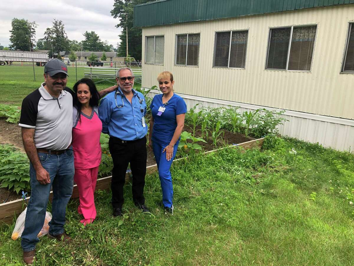 From left to right, groom Juan Torres, nurse Lucy Mercado-Freund, Dr. Alexander Cardiel, and patient care coordinator Migdalia Torres pose outside the health clinic ofnon-profit organization Backstretch Employee Service Team of NY (BEST)at the Saratoga Race Course on Thursday, July 18, 2019.