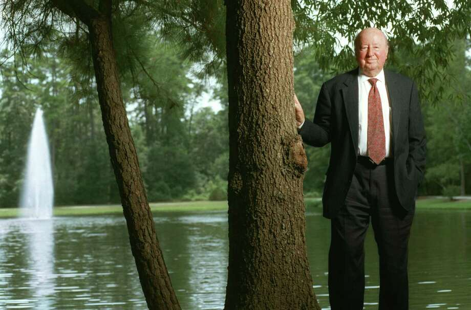 In this photo from 2001, George Mitchell stands near his office building in The Woodlands, the development he created. Mitchell died in 2013. Photo: Karen Warren, Staff / Houston Chronicle / Internal