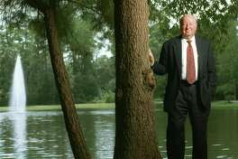 In this photo from 2001, George Mitchell stands near his office building in The Woodlands, the development he created. Mitchell died in 2013.