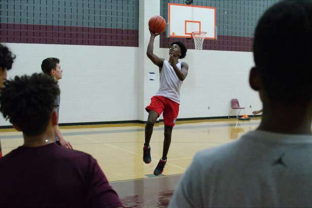 Jaylin Lowery lays up a shot at the Pearland summer basketball camp.